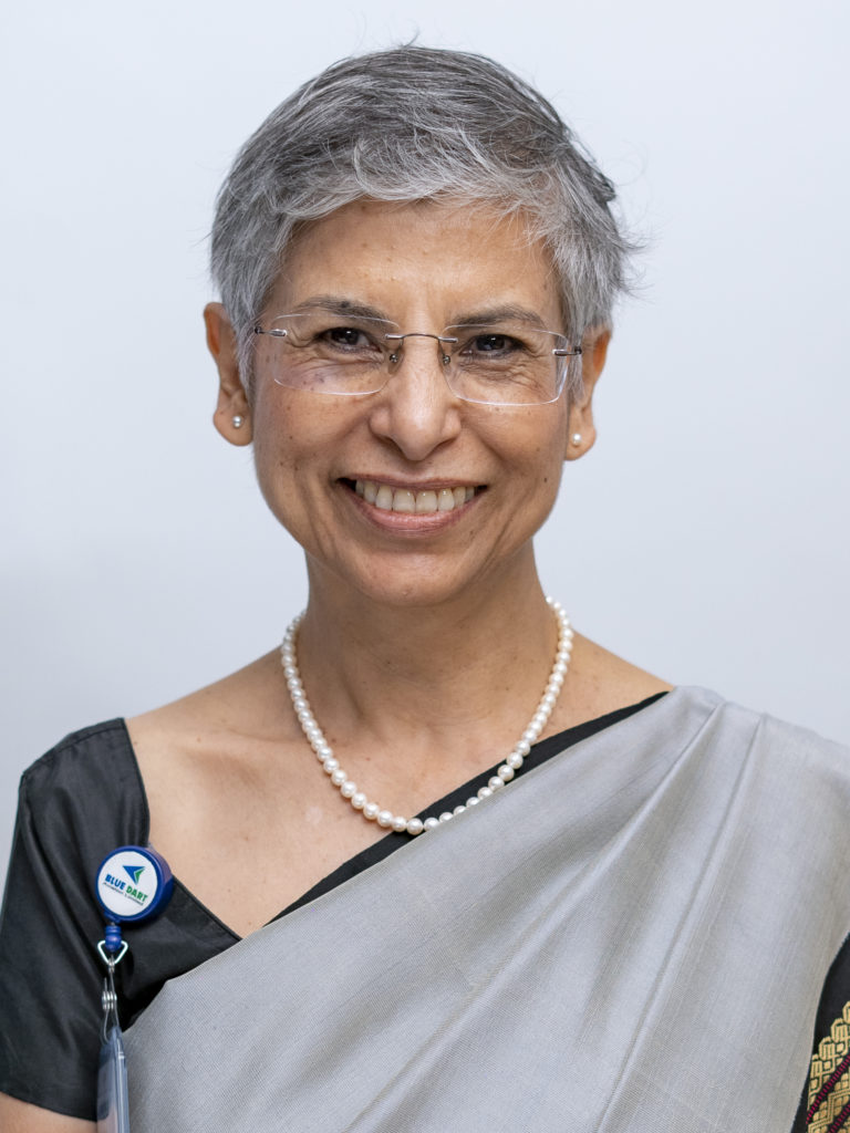 A profile photo of Blue Dart's managing director, who is seen wearing a sari, pearls and glasses