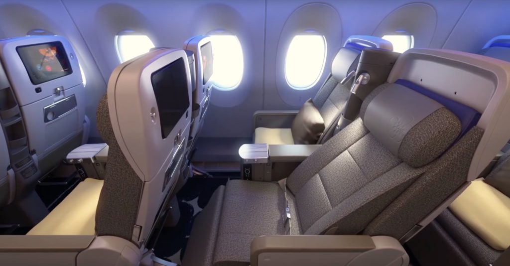 China Airlines' premium economy seat in beige, and reclined. The recline exposes the shell and full height thermoplastics