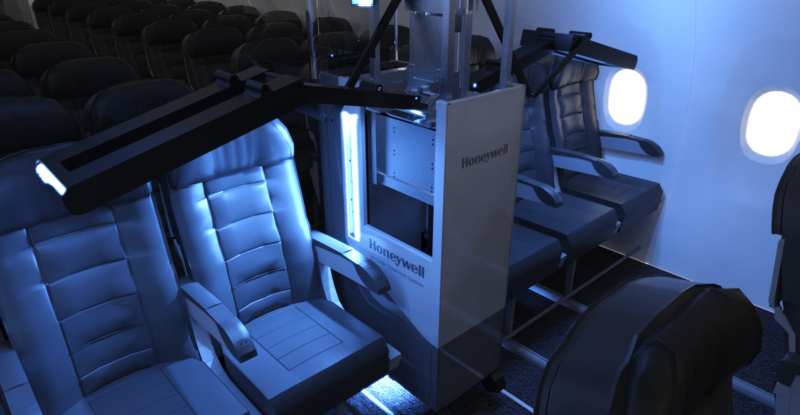 Honeywell UV Cabin System, shown, bathes an aircraft cabin in UVC light. A blue light bathes seats on board an aircraft, and the system's arms are extended to provide coverage