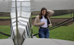 Ellie Carter is pictured in front of the 77-year-old Piper Cub