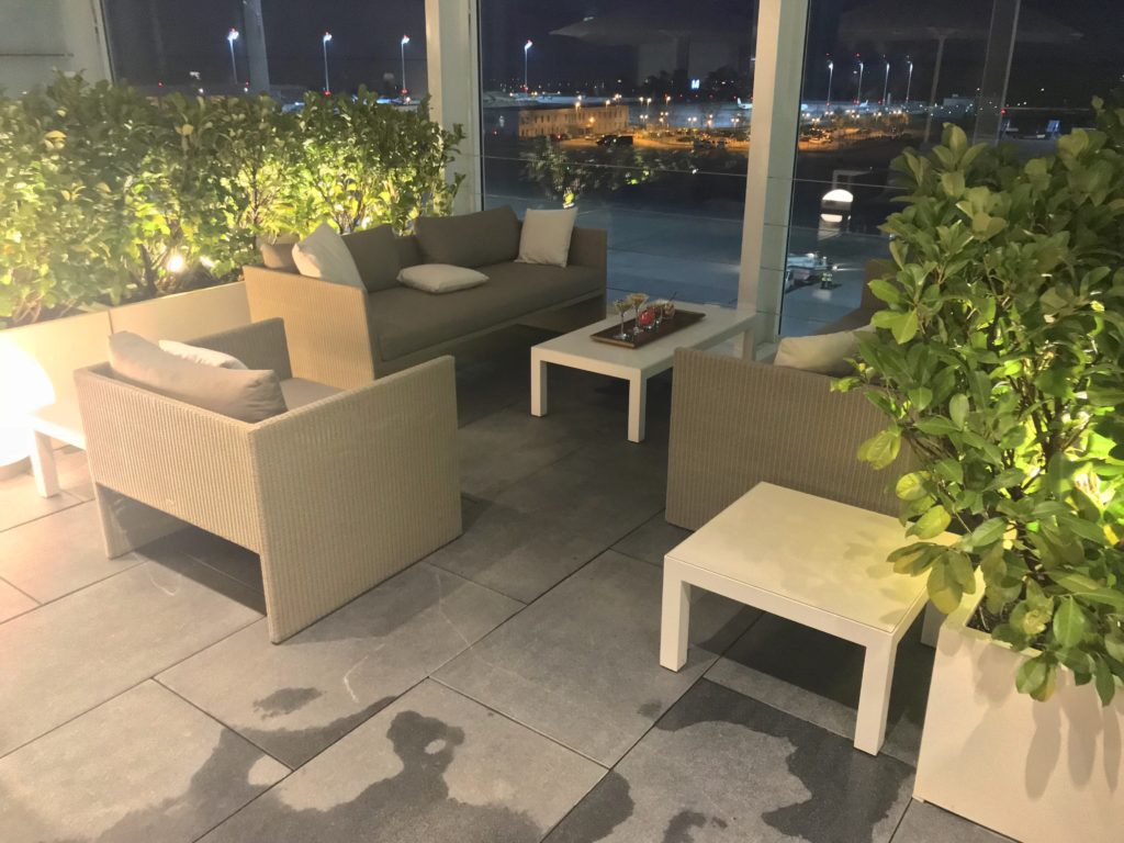 The open air space at Lufthansa's Munich first class lounge with comfortable seating, and greenery