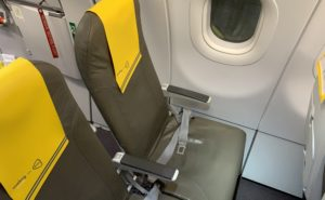 Slimline seats on Vueling are greyish beige with yellow headrest covers