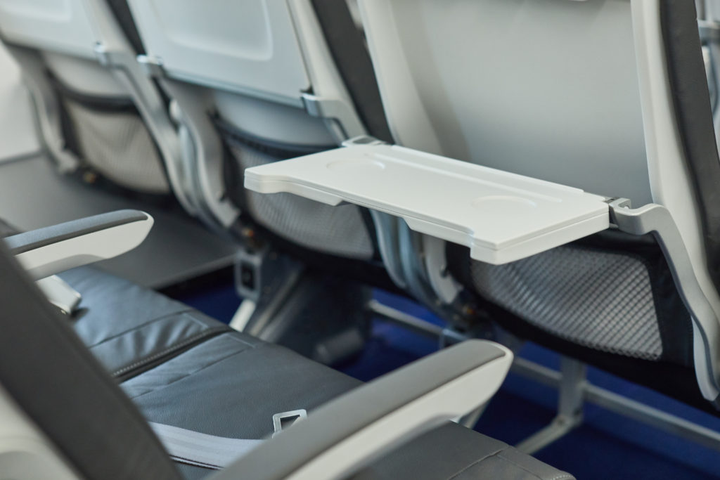 An aircraft seat tray table