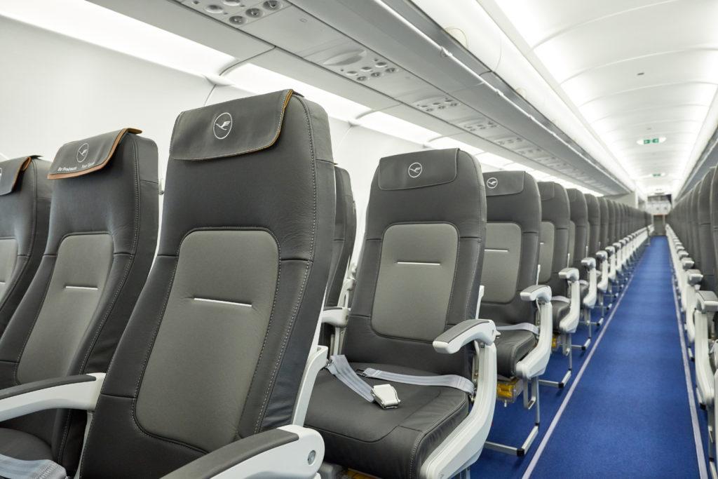 Rows of slimline seats on a Lufthansa aircraft