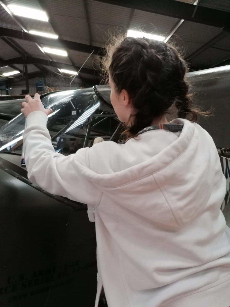 Ellie Carter inspects her aircraft.