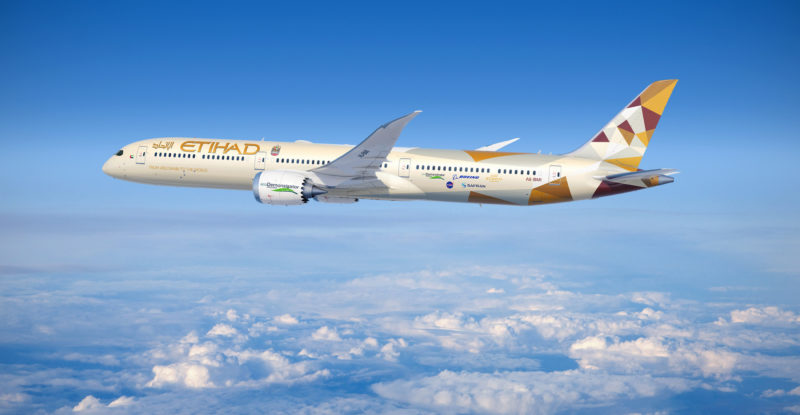 An Etihad 787-10 in-flight. The skies are blue with clouds, ecoDemonstrator