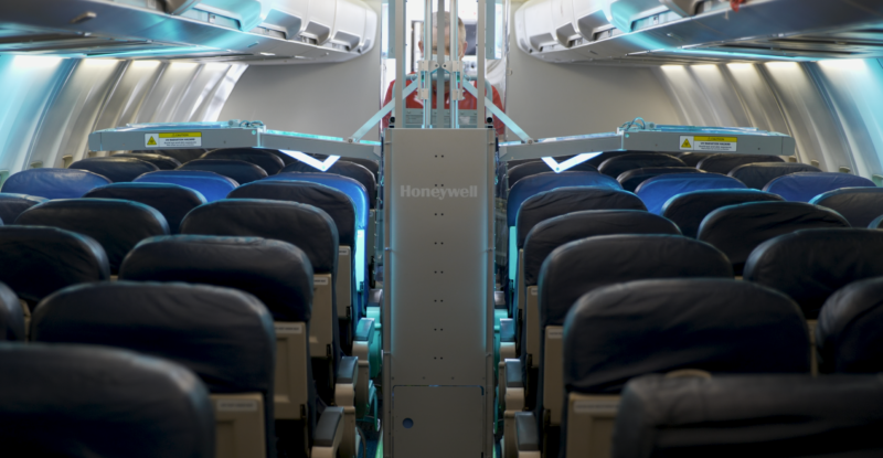 Honeywell UV Cabin System in use aboard a JetBlue A320. The system's arms stretch out over the seats to disinfect with UVC light
