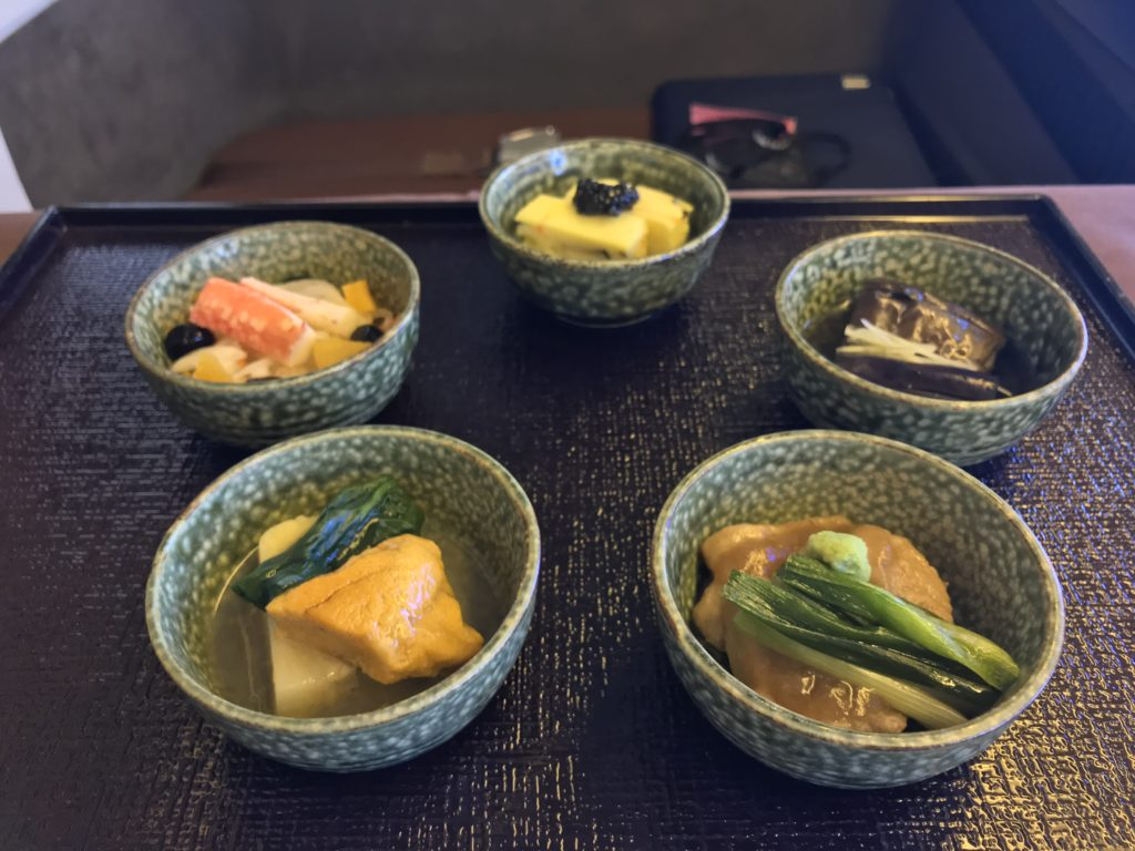 Small Japanese dishes on a black tray