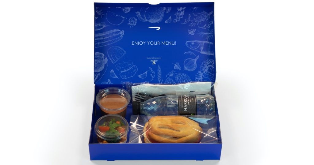 British Airways' boxed lunch with water bottle, salad, and sandwich in a blue box