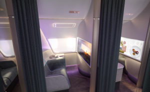 A premium class seat in its own enclosure, with curtains for privacy