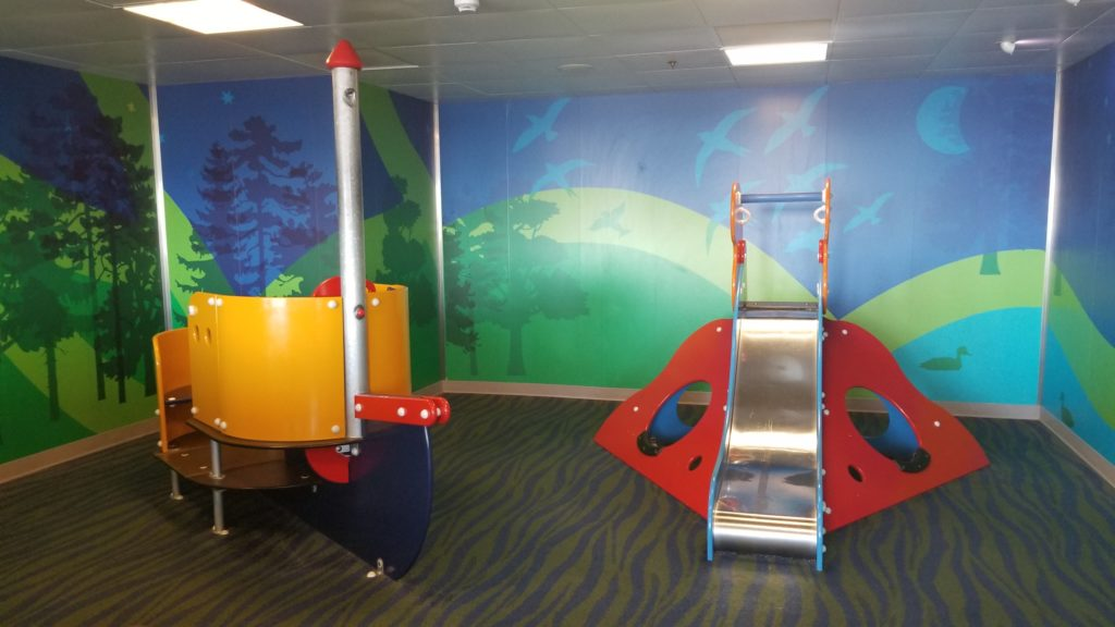 A BC Ferries playroom with slide and colorful walls