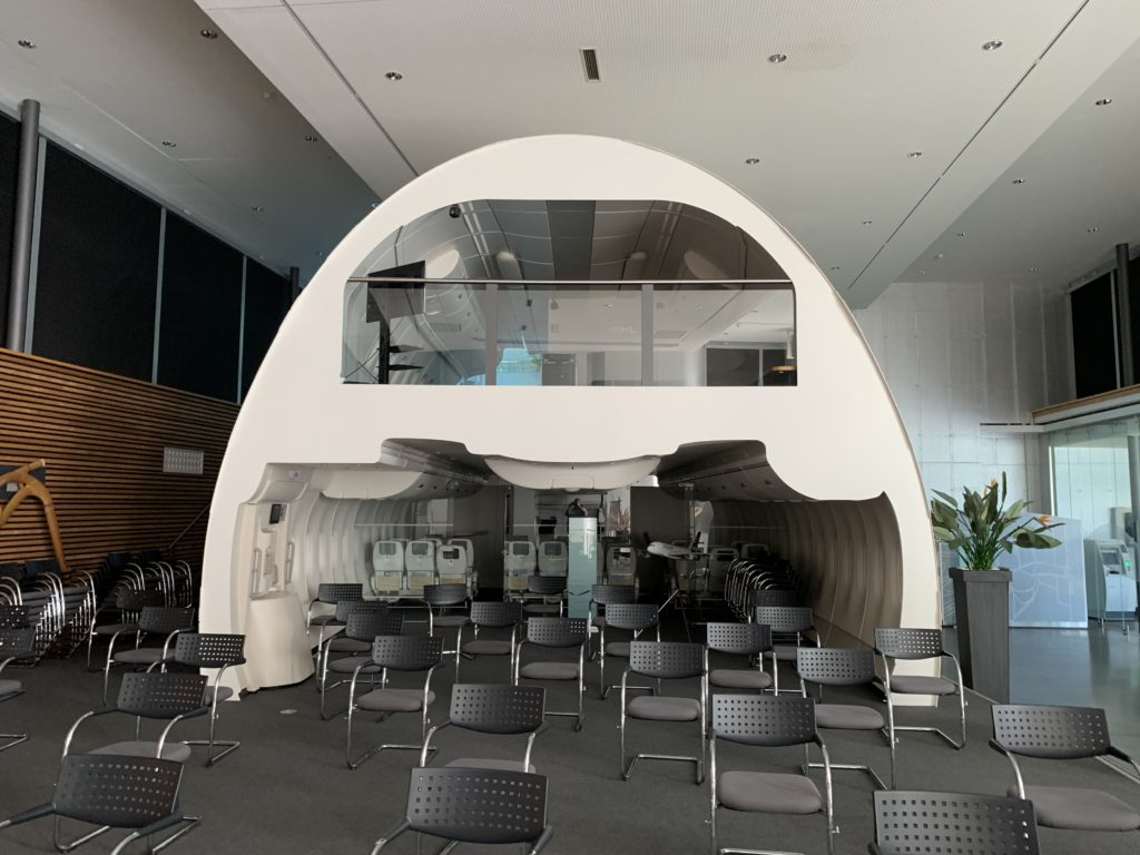 A mock-up of the cross section of an A380 at Diehl's headquarters. Seats in front of the mock-up are spaced 6ft apart amid the COVID pandemic.
