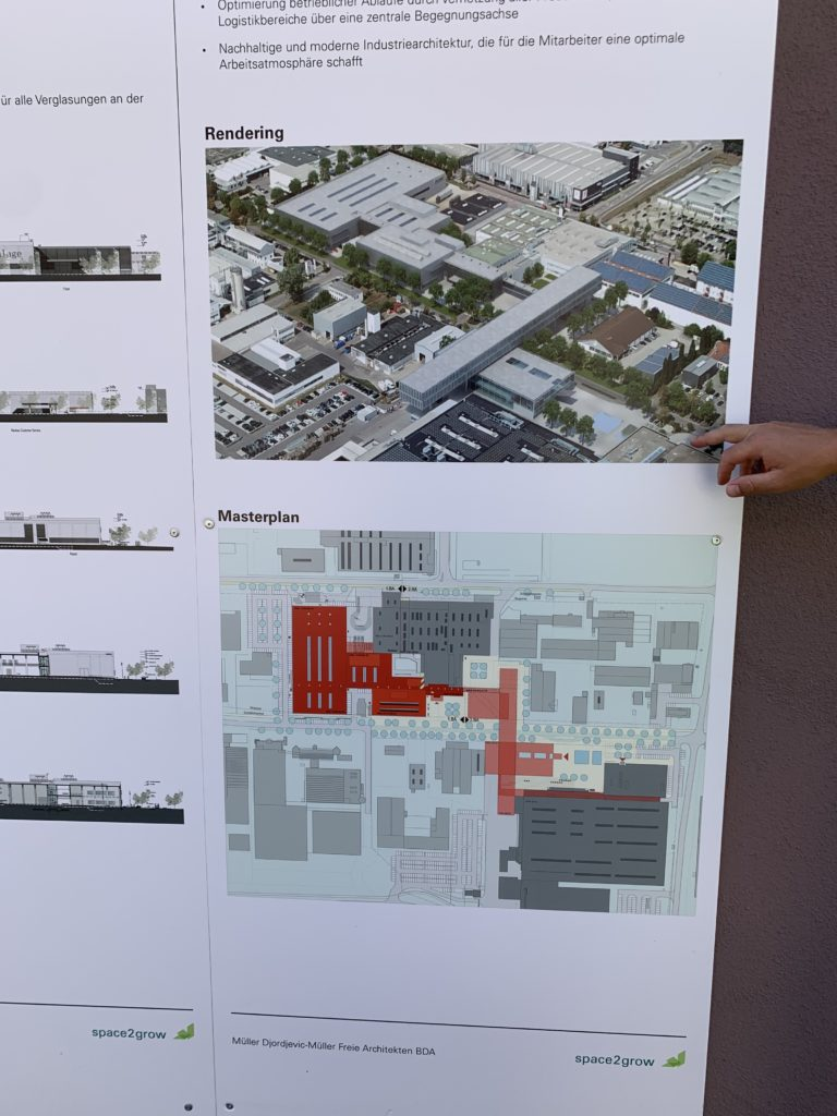A graphic on cardboard showing the final plan for Recaro's expanded facilities. Buildings are shown in red to represent the red phase