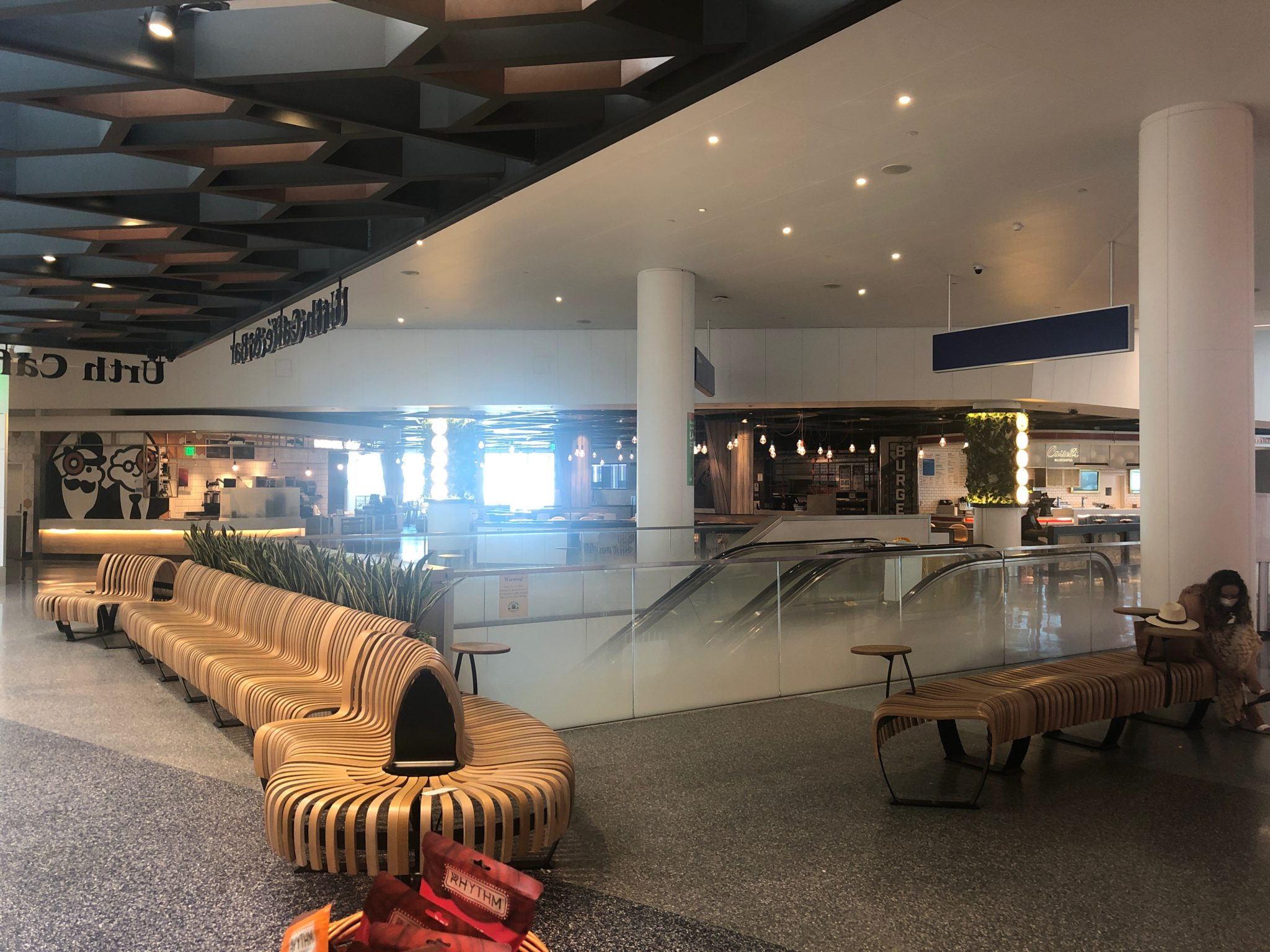 Empty bench-style seats and empty halls at LAX