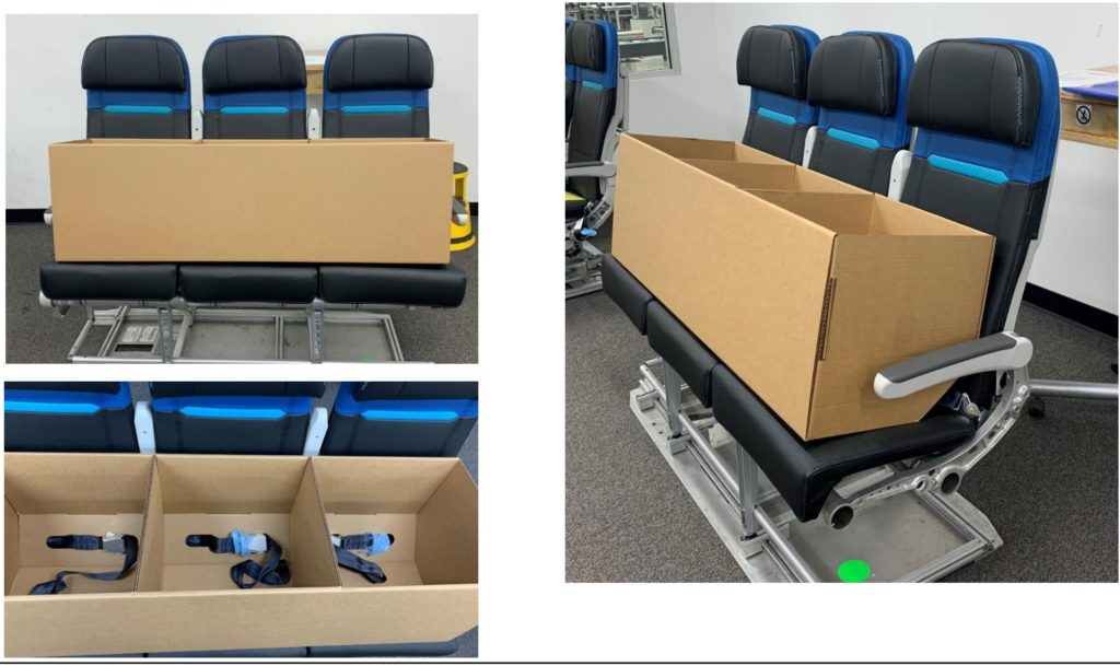 Cardboard boxes on top of economy class seats in a room
