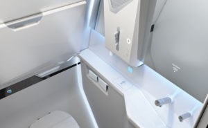 Touchless lavatory by Diehl is pictured here. All white aircraft lavatory.