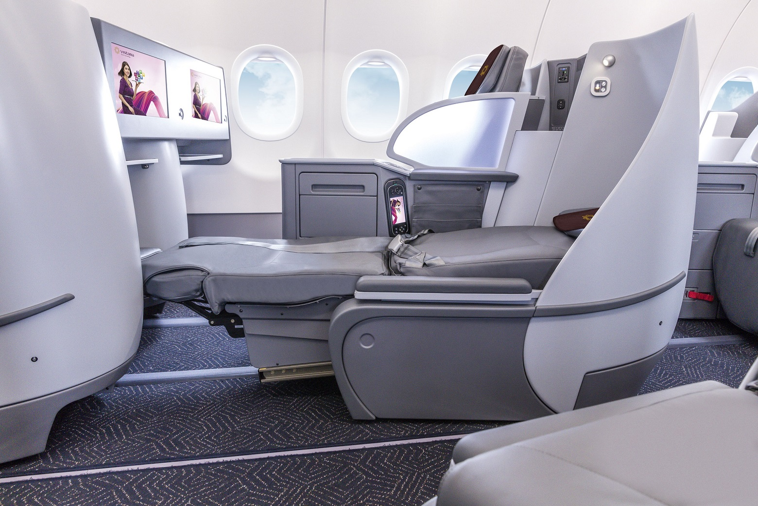 "An image of Vistara's new A321neo business class seat, which offers a full-flat position and 16"" HD touchscreens. T"