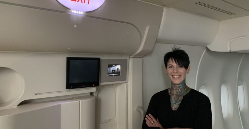 Annica Dieterich smiling inside a Diehl aircraft cabin mock-up
