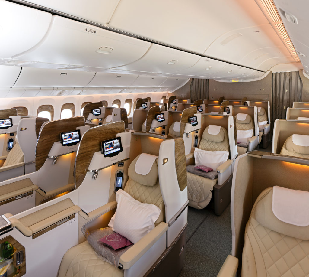 Rows of business seats, forward-facing, on board an Emirates widebody