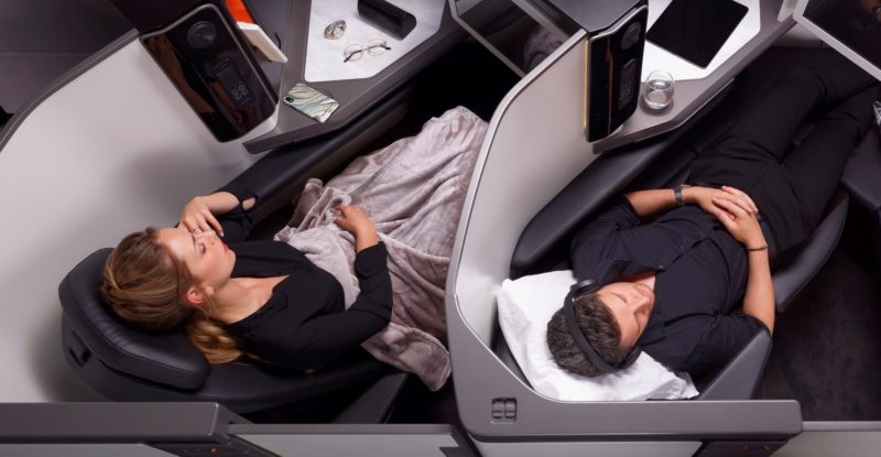 The new Stelia Opera seat is shown, with two passengers, in side-by-side seats, laying flat