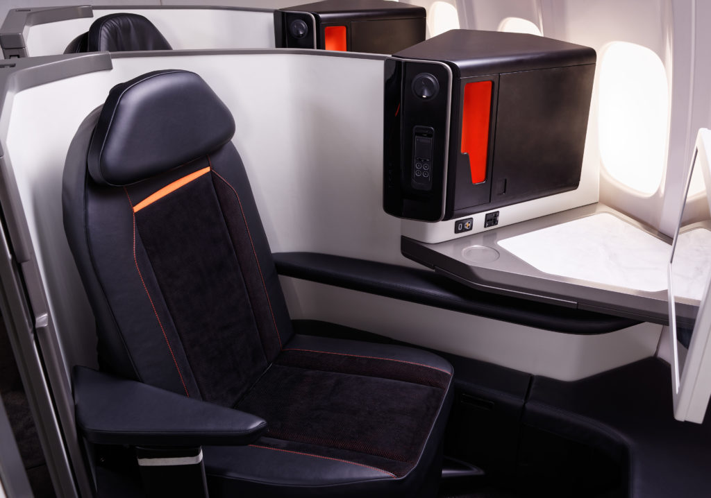 The Opera seat on board an aircraft. The seat is shown in black leather with white and grey thermoplastic shrouding.