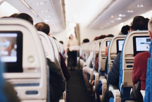 Rows of seatbacks on board an aircraft