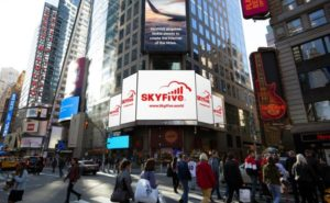 SkyFive logo on a screen in Time Square