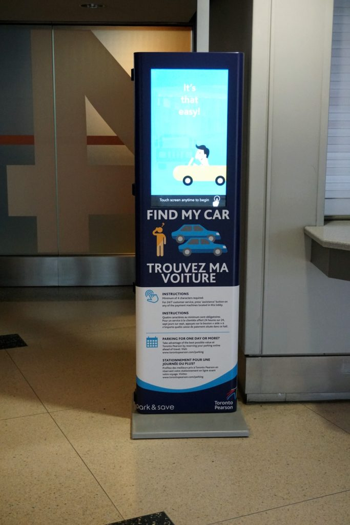 Find my car kiosk in terminal entry way, large touchscreen surface.
