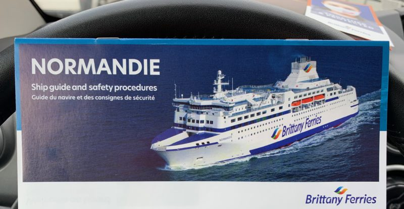 A photo of the Normandie ferry brochure on the author's steering wheel