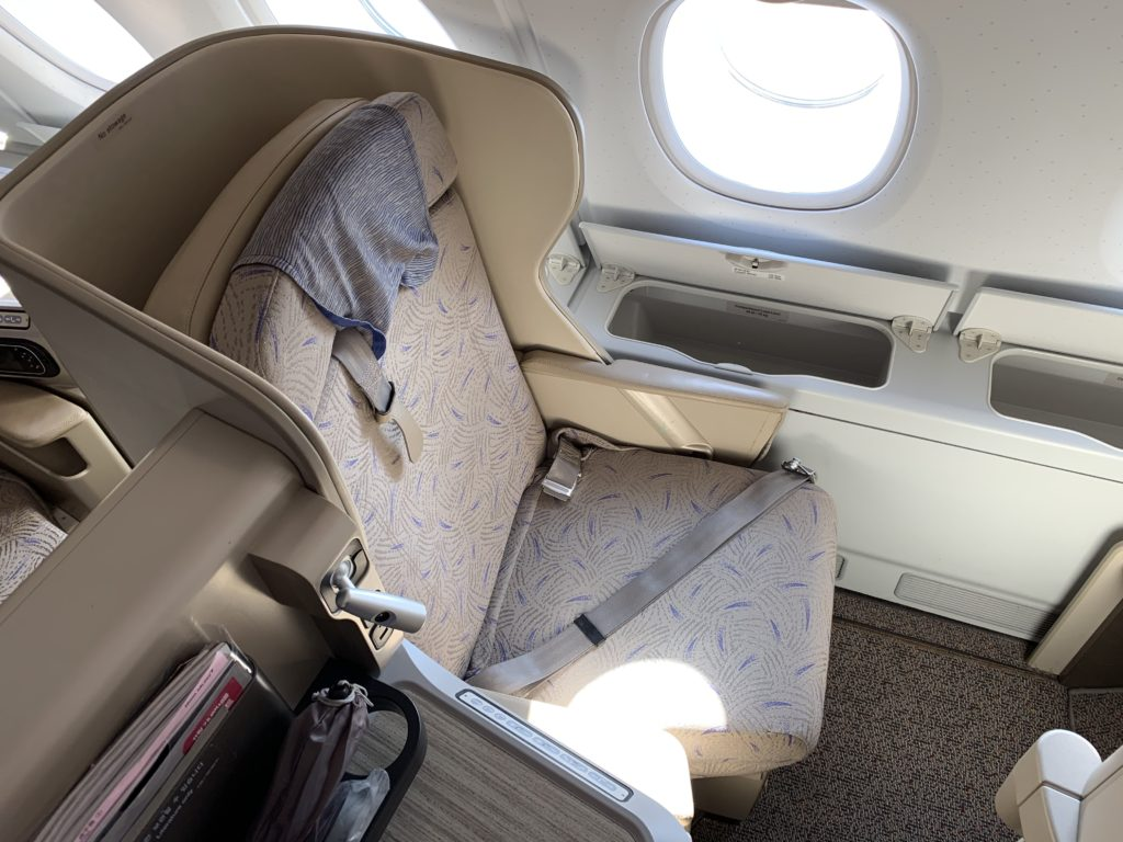 The Asiana business class seat is shown. It is beige, and easily rebrandable
