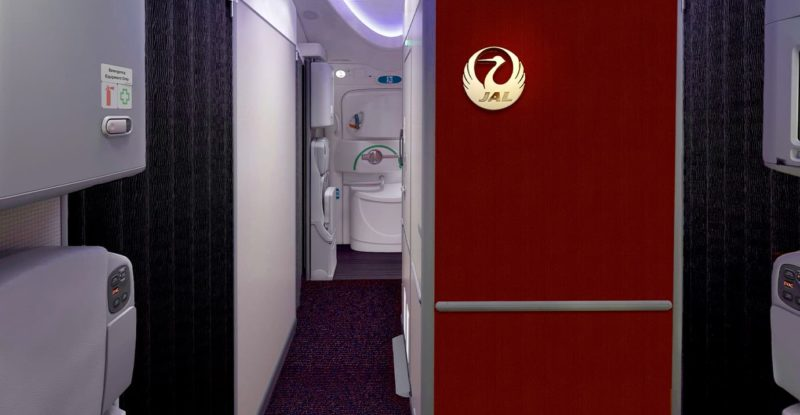 JAL Boeing 787 interior of the aircraft with red wall and JAL logo in gold