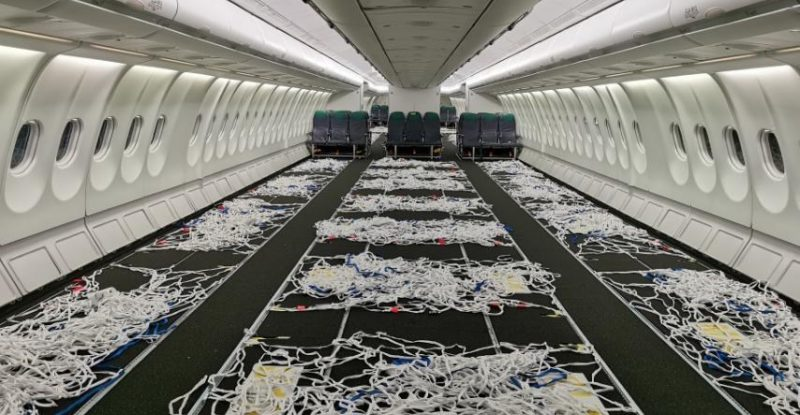 Empty A330 cabin with cargo nets layin out.