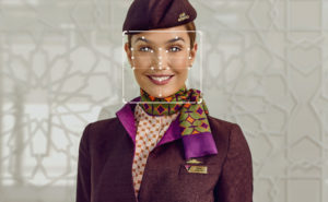 Etihad Airways female cabin crew member in uniform with biometrics dots and lines in front of her face