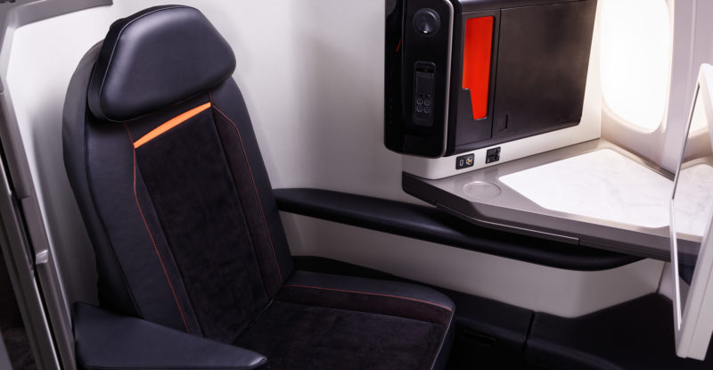 The Opera business class seat, clad in black leather.