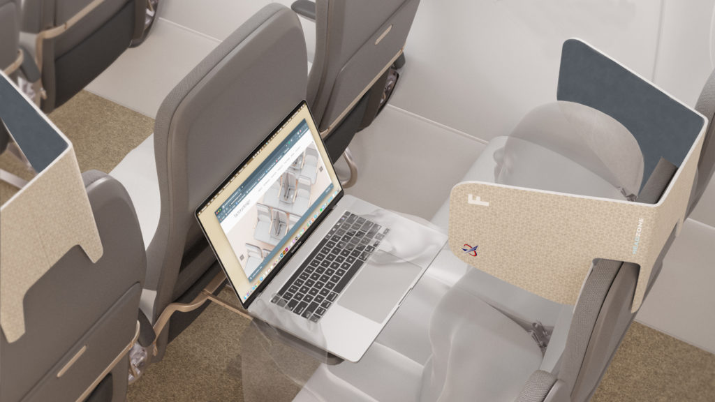 A graphic of passenger seated in a middle seat with the cardboard HeadZone product attached. The passenger is using a laptop on the tray table.