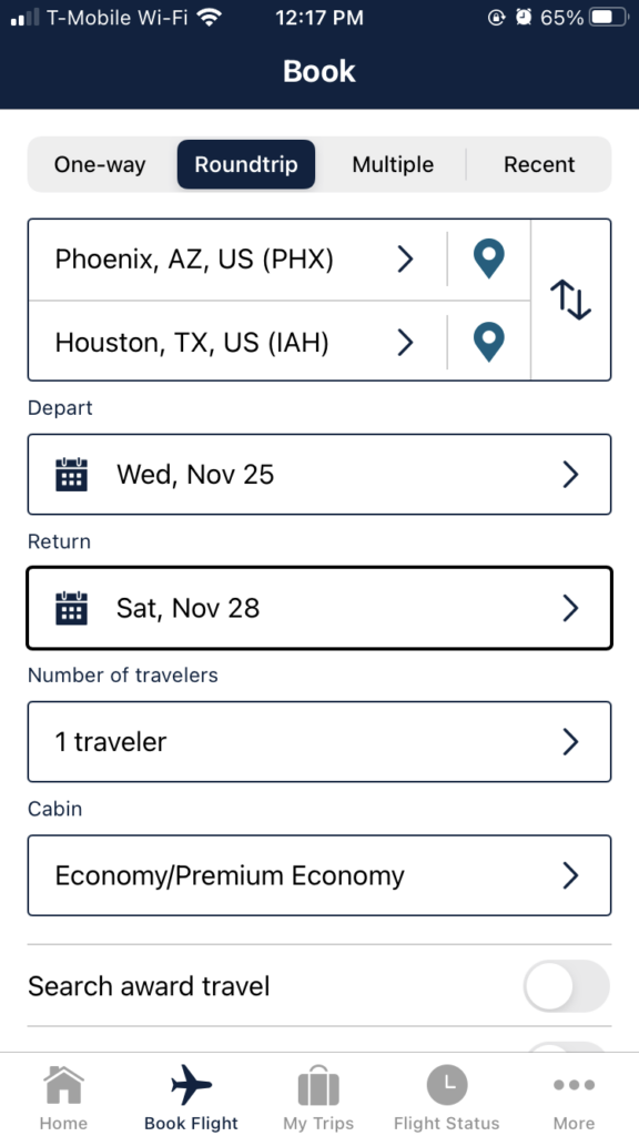 "With dark bluish black & white contrast, the ""Book Flight"" page on the app, which allows the user to plug in their desired city pair, and dates of travel."