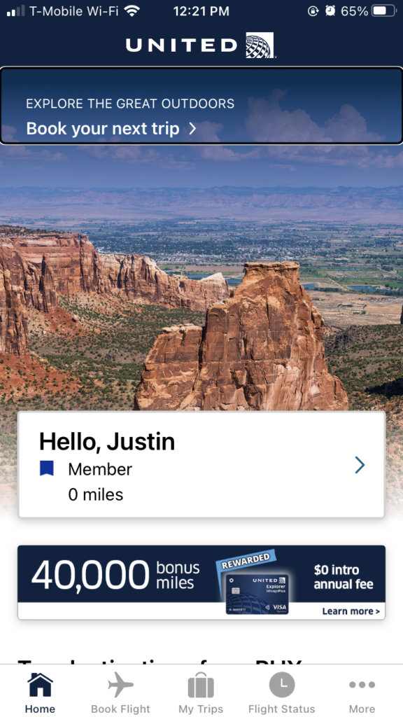 "The home screen of United's app, saying ""hello Justin"" and showing a link to book your next trip"