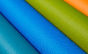 Eleather, leather rolls up close. Blue, Green and orange examples.