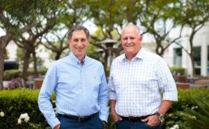 A photo of Viasat executives: Mark Dankberg, executive chairman and Rick Baldridge, president and CEO