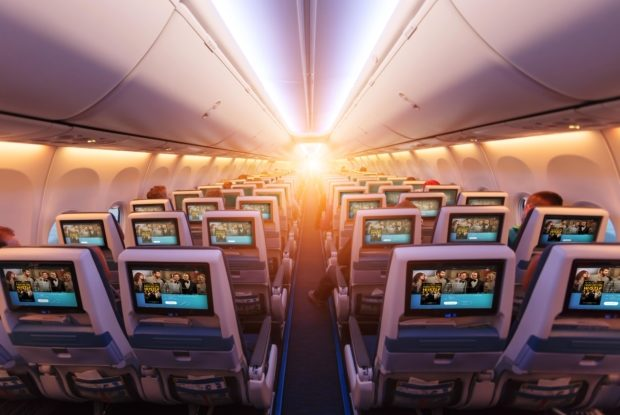 Seatback view of a Uganda Airlines aircraft interior