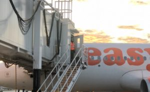 Generic An easyJet A320 at the gate, with the jetway in view