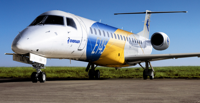 Embraer E-145 on tarmac with blue white and yellow livery