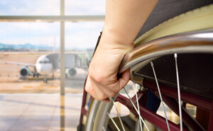 Rear view of a man in wheelchair at the airport