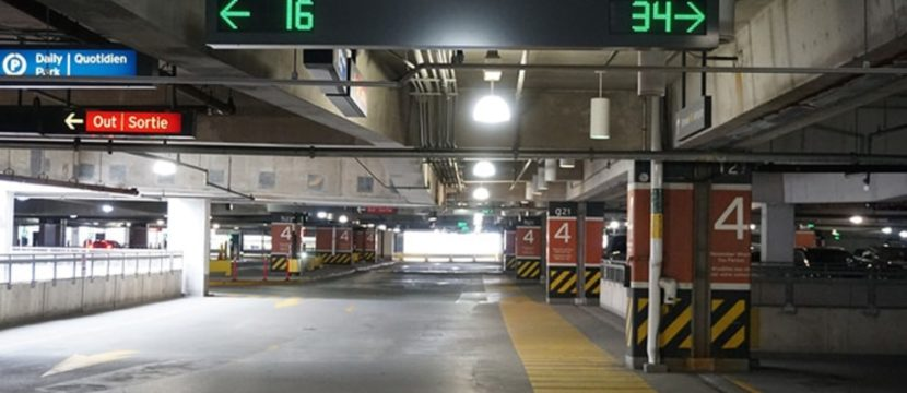 Inside the parking garage, lights indicate if spaces are available in a given row