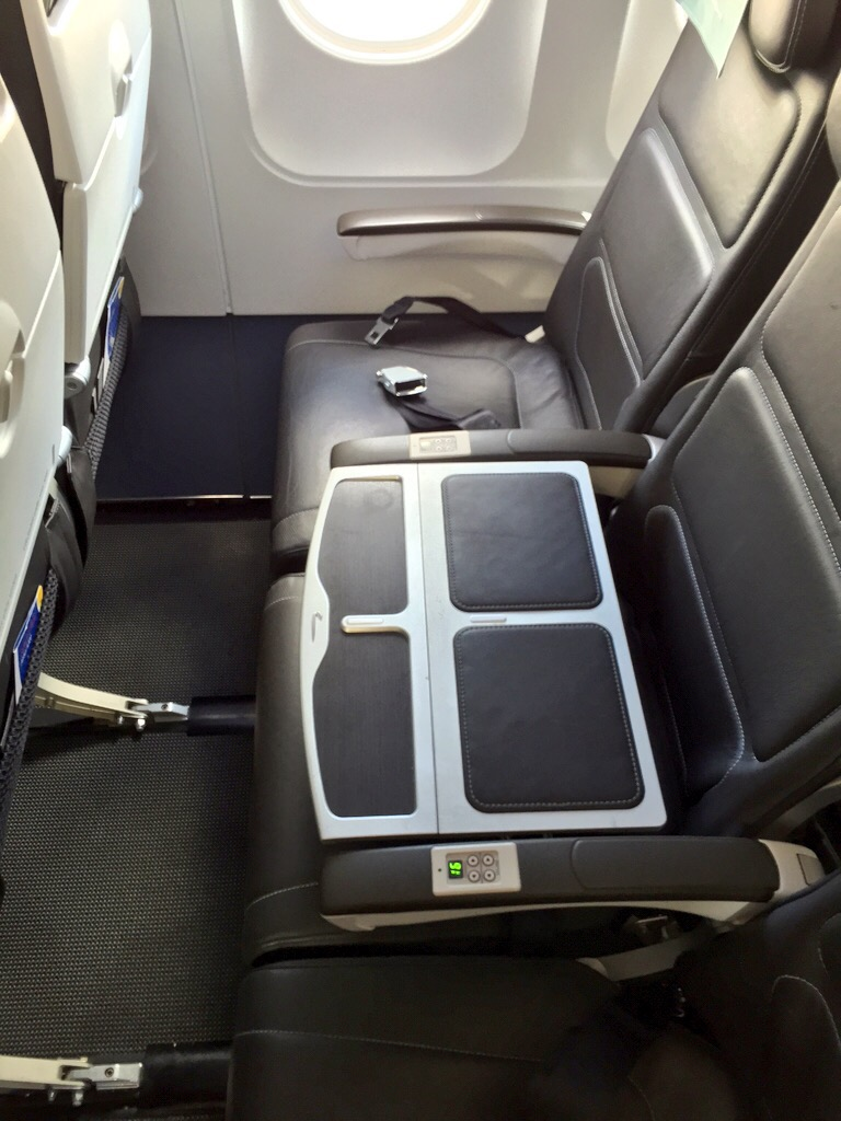British Airways' Club World seats, showing a table separating the window and aisle seats