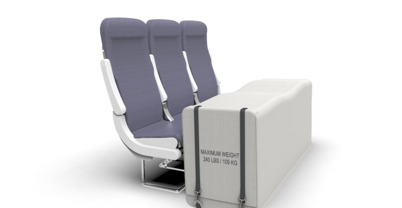 Aircraft slimline seats in greay with the storwage floor mount place in front of it on a white background