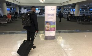 A passenger checks out information about GoEatMDW.com, a mobile food ordering app just introduced at Midway International Airport.