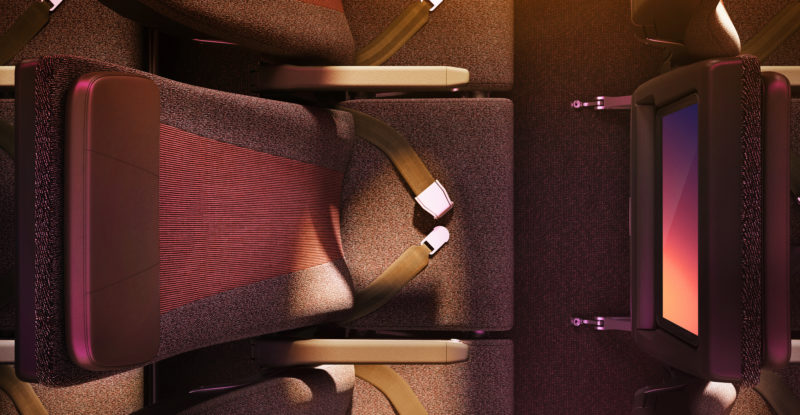 The impressive bespoke economy class seat design seen aboard Virgin Atlantic's A350. Image from Virgin shows a view from the overhead, looking down at the sleek, modern, seat and seatback IFE