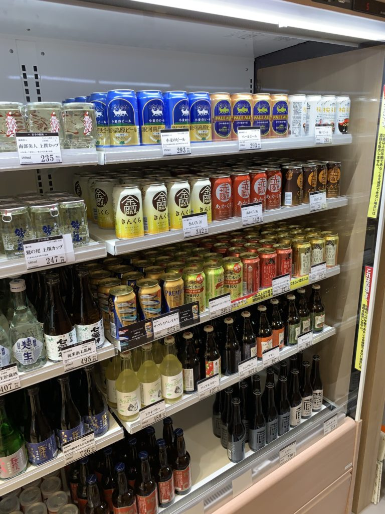 Shelves in a small station store featuring different types of beverages