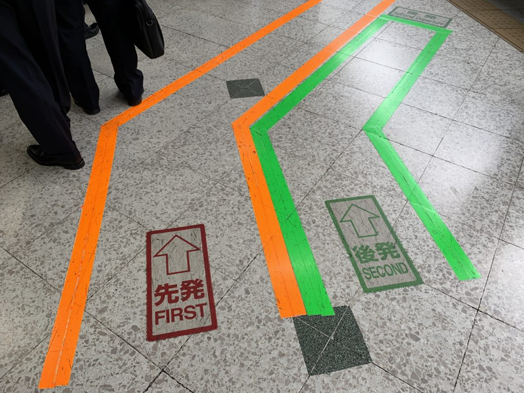 """Markings on the floor to direct """"first"""" and """"second"""" class passengers"""